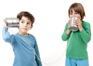 Two boys communicate through tin cans connected by string