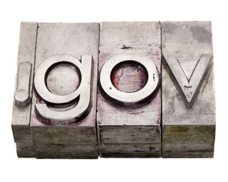 The letters .gov in vintage stained metal letterpress printing blocks