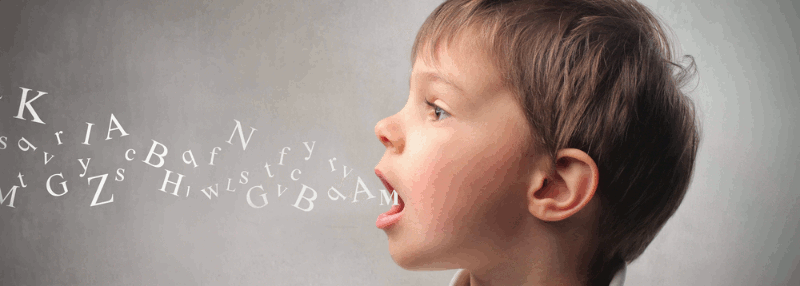 A boy with jumbled alphabet letters flowing from his open mouth