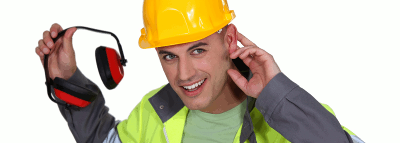 A workman in hard had and fluorescent vest holds hearing protection and a hand behind his ear